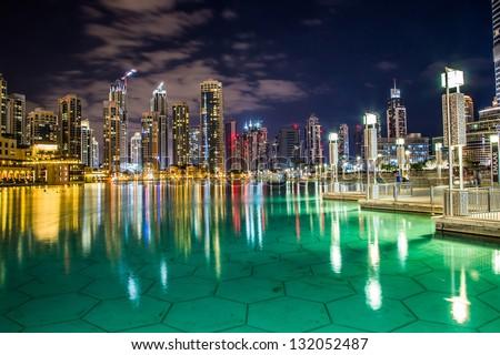 DUBAI, UAE - NOVEMBER 13: Dubai downtown night scene with city lights, luxury new high tech town in middle East, United Arab Emirates architecture  on November 13, 2012 in Dubai, UAE. - stock photo