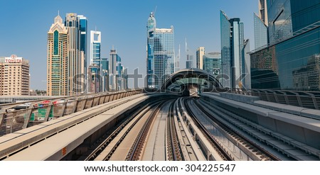DUBAI, UAE - NOVEMBER 3: Dubai Metro as world's longest fully automated metro network (75 km) on November 3, 2013, Dubai, UAE. - stock photo