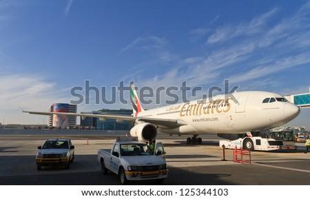 DUBAI, UAE - NOVEMBER 10: Emirates Airbus A330 at Dubai Airport on November 10, 2012 in Dubai, UAE. Emirates handles major part of passenger traffic and aircraft movements at the airport. - stock photo
