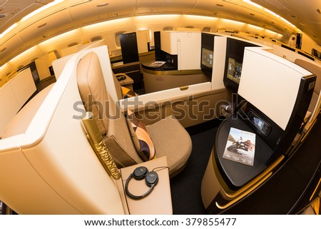 Dubai, UAE - NOVEMBER 09, 2015: Etihad Airways Airbus A380 business class luxury seats. Etihad airways business class. Etihad Airways E-BOX inflight entertainment system on November 09, 2015 in Dubai - stock photo
