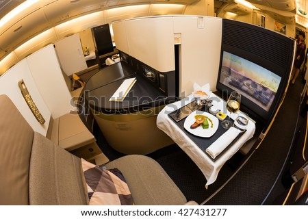 Dubai, UAE - NOVEMBER 09, 2015: Etihad Airways Airbus A380 business class luxury seats. Etihad airways business class. Etihad Airline on board dining,meals,food on November 09, 2015 in Dubai - stock photo