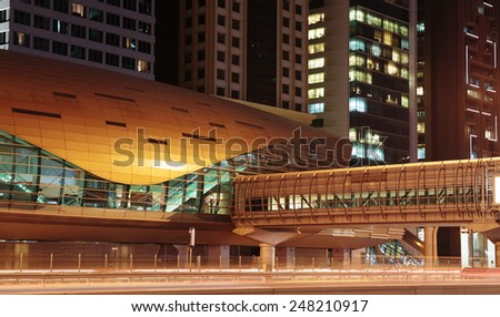 DUBAI, UAE - NOVEMBER 14: Metro subway station at night. Dubai Metro as world's longest fully automated metro network (75 km) on November 14, 2013, Dubai, UAE. - stock photo