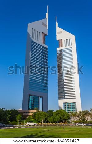 DUBAI, UAE - NOVEMBER 9: Modern skyscrapers, Sheikh zayed roads on November 9, 2013 in Dubai, United Arab Emirates. Dubai is the fastest growing city in the world. - stock photo