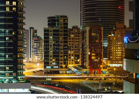 DUBAI, UAE - NOVEMBER 12: Nigh view of the Dubai Marina district Greens, on November 12, 2012, Dubai, UAE. Dubai was the fastest developing city in the world between 2002 and 2008. - stock photo