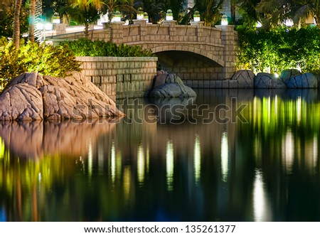 DUBAI, UAE - NOVEMBER 15: Night view of Madinat Jumeirah hotel, on November 15, 2012, Dubai, UAE. Madinat Jumeirah - luxury 5 star hotel with own artificial canals and boats. - stock photo