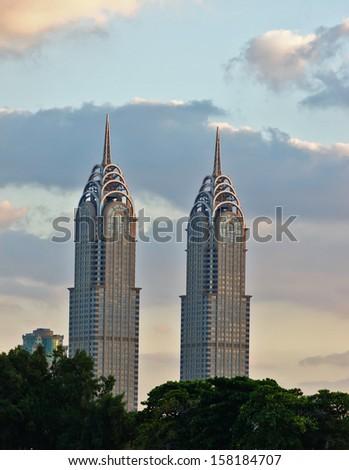 DUBAI, UAE-NOVEMBER 17: Night view of the Chrysler building in Dubai on November 17, 2012. Two imitations of NYC Chrysler building. - stock photo