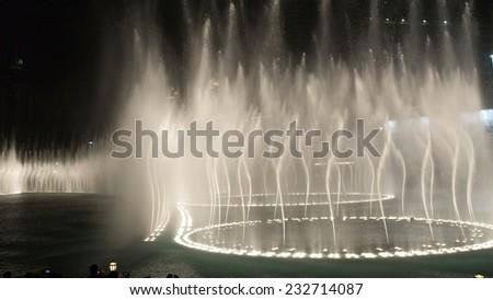DUBAI, UAE - NOVEMBER 9, 2014: Night view of the light show at Dubai Fountain. November 2014 in Dubai, UAE - stock photo