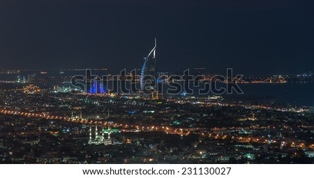 DUBAI, UAE - NOVEMBER 14 :The world's first seven stars luxury hotel Burj Al Arab seen alongside of Jumeirah Beach hotel, November 14, 2014 in Dubai, United Arab Emirates. - stock photo