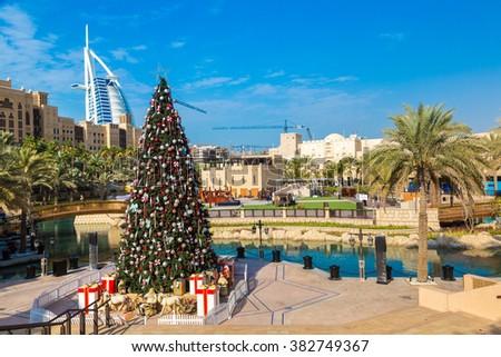DUBAI, UAE - NOVEMBER 23: View at Burj Al arab hotel from Madinat Jumeirah  and Christmas tree in Dubai, UAE on 23 November 2015 - stock photo