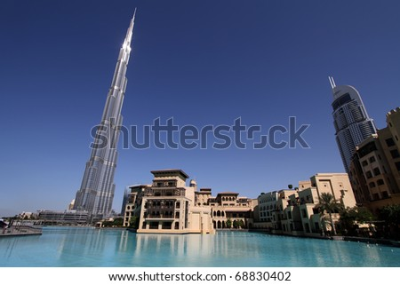 DUBAI, UAE - NOVEMBER 16: View at Burj Khalifa in Dubai, on November 16, 2010. This skyscraper is the tallest man-made structure ever built, at 828 m. - stock photo