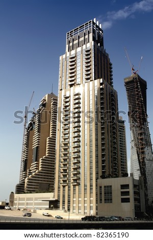 DUBAI, UAE - NOVEMBER 15: View at modern skyscrapers in Dubai Marina on November 15, 2010 in Dubai, UAE. When the entire development is complete, it will accommodate more than 120,000 people. - stock photo
