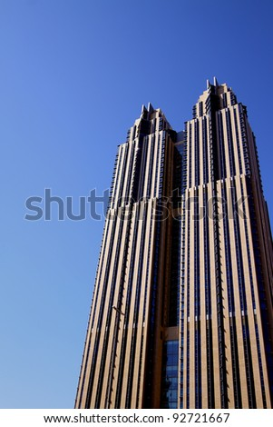 DUBAI, UAE - NOVEMBER 17: View at Sheikh Zayed Road skyscraper in Dubai at November 17, 2010. More than 25 skyscrapers taller than 100 meters can be found there. - stock photo