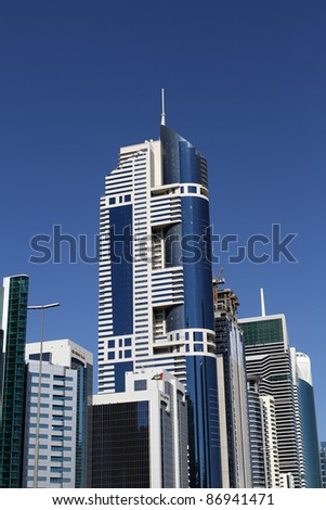 DUBAI, UAE - NOVEMBER 17: View of Sheikh Zayed Road skyscrapers in Dubai, UAE on November 17, 2010. More than 25 skyscrapers taller than 100 meters can be found there. - stock photo
