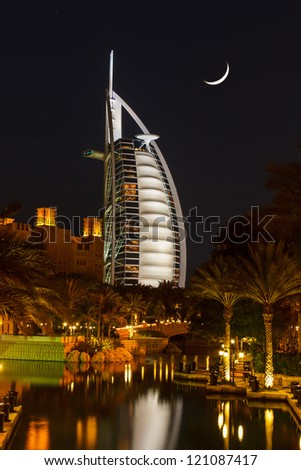 DUBAI, UAE - NOVEMBER 15: View of the hotel Burj Al Arab from Souk Madinat Jumeirah. Madinat Jumeirah encompasses two hotels and clusters of 29 traditional Arabic houses.  Nov 15, 2012 - stock photo