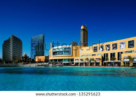 DUBAI, UAE - OCT 1: Dubai Mall and the Dubai Fountain on Oct 1, 2010 in Dubai, UAE. The Dubai Mall is the largest shopping mall in the world with some 1200 stores - stock photo