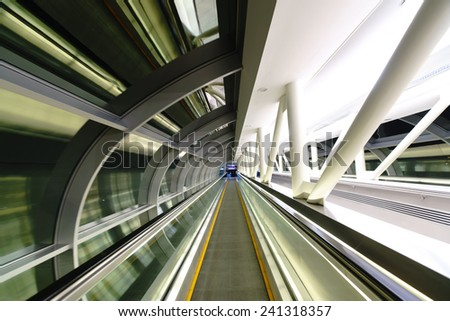 DUBAI, UAE - OCT 16: way between metro and airport on October 16, 2014 in Dubai. Dubai International Airport is an international airport serving Dubai. It is a major airline hub in the Middle East - stock photo