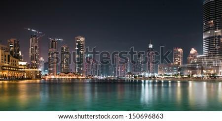 DUBAI, UAE - OCTOBER 23: A record-setting fountain system set on Burj Khalifa Lake, it shoots water 150 m into the air, at October 23, 2012 in Dubai, United Arab Emirate - stock photo