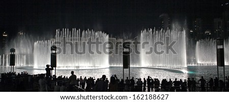DUBAI, UAE - OCTOBER 30: A record-setting fountain system set on Burj Khalifa Lake - 6600 lights and 25 projectors, it shoots water 150 m into the air, at October 30, 2012 in Dubai, UAE - stock photo