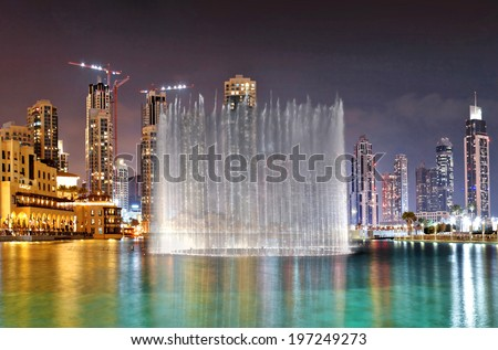 DUBAI, UAE - OCTOBER 30: A record-setting fountain system set on Burj Khalifa Lake - 6600 lights and 25 projectors, it shoots water 150 m into the air, on October 30, 2012 in Dubai, UAE  - stock photo