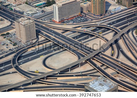 DUBAI, UAE - OCTOBER 29: Aerial view of intersection in Downtown Dubai from the tallest building in the world, Burj Khalifa on October 29, 2012 in Dubai, UAE - stock photo