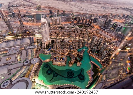 DUBAI, UAE - October 21, 2014: Dubai downtown day scene with city lights, luxury new high tech town in middle East, United Arab Emirates on October 21, 2014 in Dubai, UAE. - stock photo