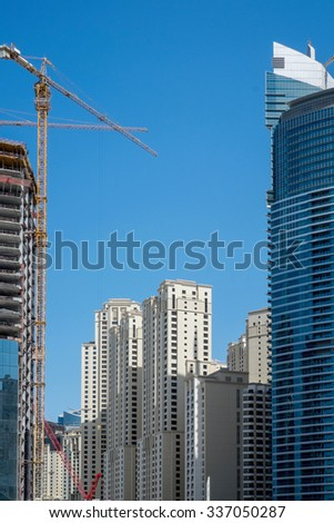 Dubai, UAE - October 01: Jumeirah beach develpment in Dubai, UAE on October 01 2015. Dubai is is the most populous city in the United Arab Emirates popular by its luxury resorts. - stock photo