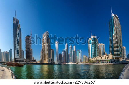DUBAI, UAE - OCTOBER 13: Modern buildings in Dubai Marina, Dubai, UAE. In the city of artificial channel length of 3 kilometers along the Persian Gulf, taken on 13 October 2014 in Dubai. - stock photo