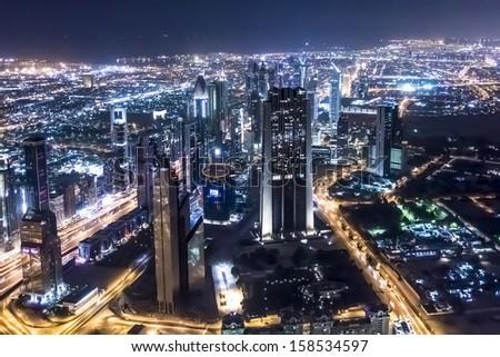 DUBAI, UAE - OCTOBER 1: Night view of Dubai from Burj Khalifa, October 1, 2012, Dubai, United Arab Emirates. Dubai now boasts more completed skyscrapers higher than 0,8 - 0,25 km than any other city. - stock photo