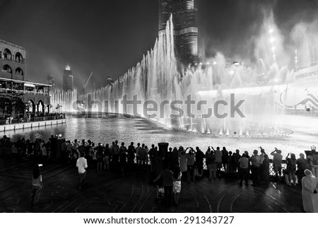 DUBAI, UAE - OCTOBER 15, 2014: The Dubai Fountain. The Dubai Fountain is the world's largest choreographed fountain system set on the 30-acre manmade Burj Khalifa Lake - stock photo