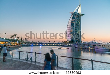 DUBAI, UAE - OCTOBER 2015 :The world's first seven stars luxury hotel Burj Al Arab, as seen at twilight. - stock photo