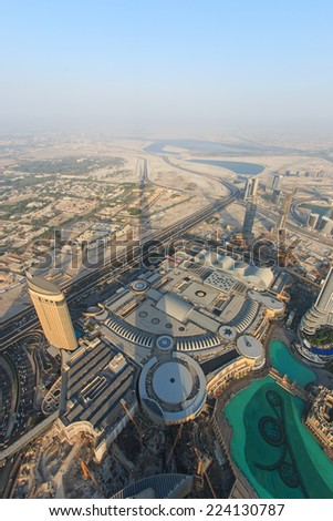 DUBAI, UAE - October 07, 2014: View of Dubai at sunset from the new worlds tallest building, the Burj Khalifa. - stock photo