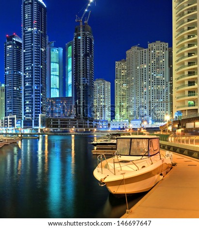 DUBAI, UAE - OCTOBER 23: View of the region of Dubai - Dubai Marina is an artificial canal city, carved along a two mile (3 km) stretch of Persian Gulf shoreline on october 23, 2012 in Dubai, UAE  - stock photo