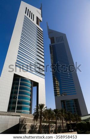 DUBAI, UAE - SEP 29, 2014: The famous Emirates towers in Dubai , UAE on Sep 29, 2014.  - stock photo