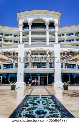 DUBAI, UAE - SEPTEMBER 10, 2015: Building of 5 stars Hotel Waldorf Astoria Dubai Palm Jumeirah on man-made island of Palm Jumeirah. United Arab Emirates.  - stock photo