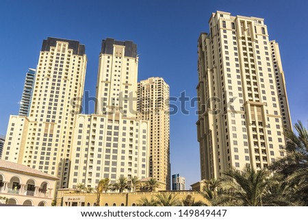 DUBAI, UAE - SEPTEMBER 30: Modern skyscrapers in Dubai (emirate and city) on September 30, 2012 in Dubai, UAE. Dubai now boasts more completed skyscrapers higher than 0,8 - 0,25 km than any other city - stock photo