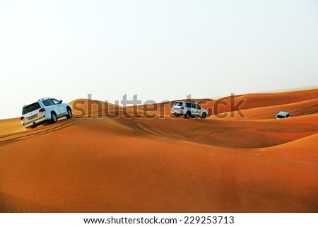 DUBAI, UAE - SEPTEMBER 12: The Dubai desert trip in off-road car is a major tourist attraction in Dubai on September 12, 2013 in Dubai, UAE - stock photo