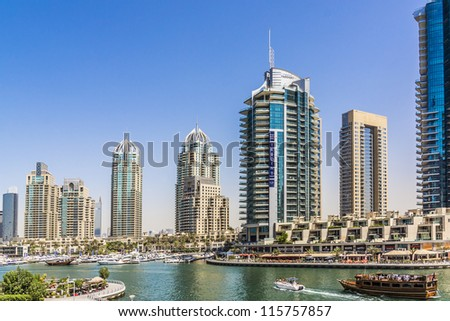 DUBAI, UAE - SEPTEMBER 29: View of modern skyscrapers in Dubai Marina on September 29, 2012 in Dubai, UAE. Dubai Marina - artificial canal city, carved along a 3 km stretch of Persian Gulf shoreline. - stock photo