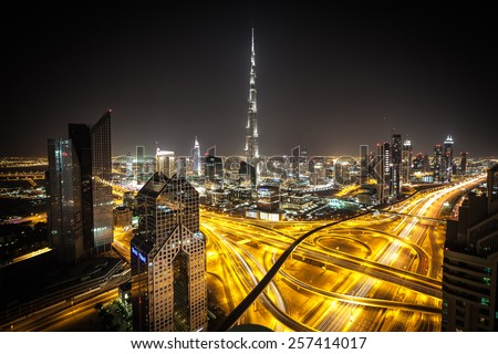 DUBAI, UNITED ARAB EMIRATES - CIRCA DECEMBER 2012 - Burj Khalifa, tallest building in the world, standing over Sheikh Zayed Road at night.  - stock photo