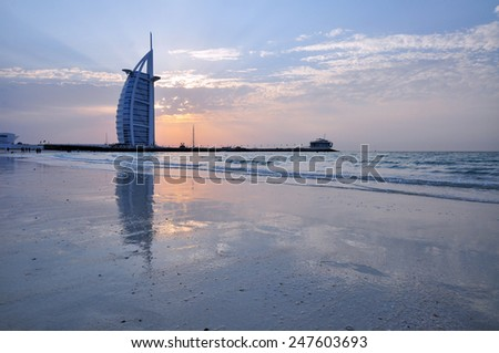 DUBAI, UNITED ARAB EMIRATES - CIRCA JANUARY 2014: The Burj Al Arab in Dubai, United Arab Emirates, at the sun set. This is one of the most expensive hotels in the world, and the first 7 stars hotel.  - stock photo