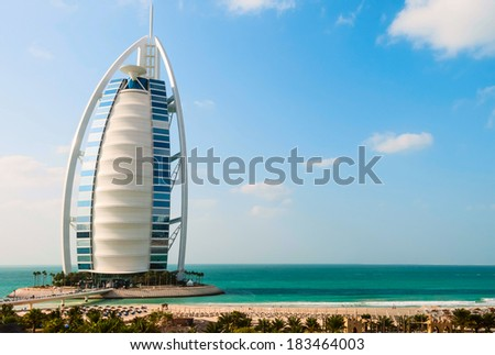 "DUBAI, UNITED ARAB EMIRATES - DECEMBER, 10, 2013: A general view of the world's first seven stars luxury hotel Burj Al Arab ""Tower of the Arabs"", also known as ""Arab Sail"" - stock photo"