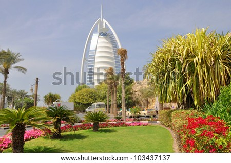 DUBAI, UNITED ARAB EMIRATES - MARCH 10: Burj Al Arab luxury hotel seen from the entrance on March 10, 2011 in Dubai, UAE. The hotel stands on an artificial island 280m out from Jumeirah beach. - stock photo