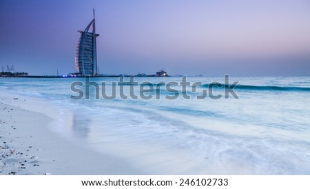 "DUBAI, UNITED ARAB EMIRATES - MAY 3: Burj Al Arab (Tower of the Arabs), a luxury 5 Star hotel located in Dubai, United Arab Emirates on May 3, 2012. It is called ""The world's only 7 star Hotel"". - stock photo"