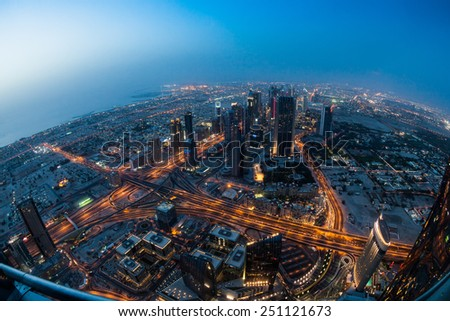 DUBAI, UNITED ARAB EMIRATES - MAY 2: Burj Khalifa skyscraper in Dubai, United Arab Emirates on May 2, 2012. It is the tallest artificial structure in the world, standing at 829.8 m (2,722 ft) - stock photo