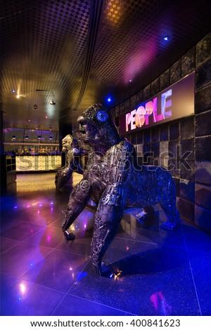 Dubai, United Arab Emirates, 08/080/2015, People by Crystal, Dubais best nightclub, Raffles. The iconic metal cog gorilla sculptures in a neon light setting. - stock photo