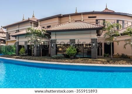 DUBAI, UNITED ARAB EMIRATES - SEPTEMBER 10, 2015: Anantara Dubai the Palm Resort & Spa (260 luxury suites, penthouses and villas) on man-made Island of Palm Jumeirah. Pools and villas. - stock photo