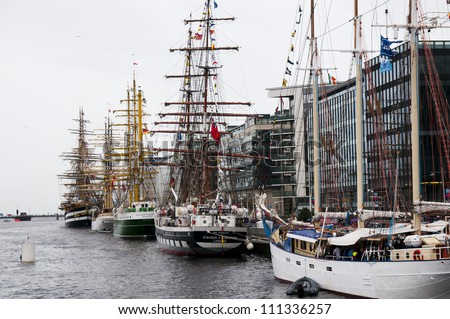 DUBLIN - AUGUST 24: Tall ships sits in the Dublin harbor on August 24, 2012 in Dublin, Ireland. It is a number of tall ships that will participate in the Tall Ships Race - stock photo
