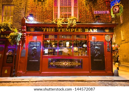 DUBLIN, IRELAND - APR 1: Night street scene in the Dublin, Ireland Temple Bar historic district on April 1 2013. This landmark medieval area is known as Dublins cultural quarter with lively nightlife. - stock photo