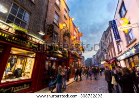 DUBLIN, IRELAND - APRIL 17, 2011:  Blurred defocused illuminated.Many people spend their nightlife around the popular historical landmark of Dublin - Temple Bar district on April 17, 2011. - stock photo