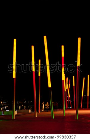 DUBLIN, IRELAND - AUGUST 23: Grand Canal Square, designed by leading international landscape architects and urban designers Martha Schwartz Partners at night time on August 23, 2011 in Dublin, Ireland - stock photo