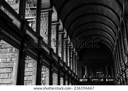 DUBLIN, IRELAND - JULY 6, 2013. Trinity College Library as seen from the inside. Many movies were recorded inside this library, and here is also where the Book of Kells is. - stock photo